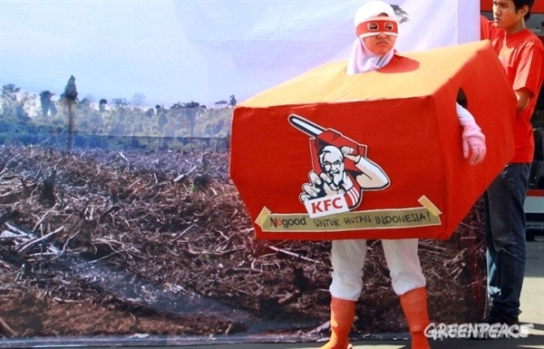 21 June 2012, Jakarta, Indonesia - Greenpeace activists protest outside a KFC outlet in Jakarta.