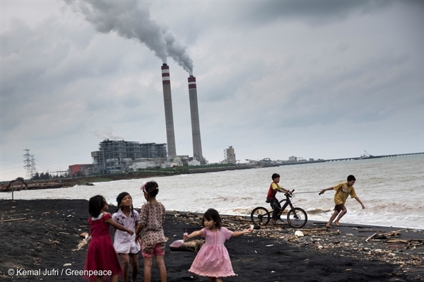 Children play by the beach near a coal power plant in Jepara, Central Java, oblivious to the possible threats to their health. The coal mining furore poses serious hazards to human health, the environment and the social integrity of communities around mining areas.