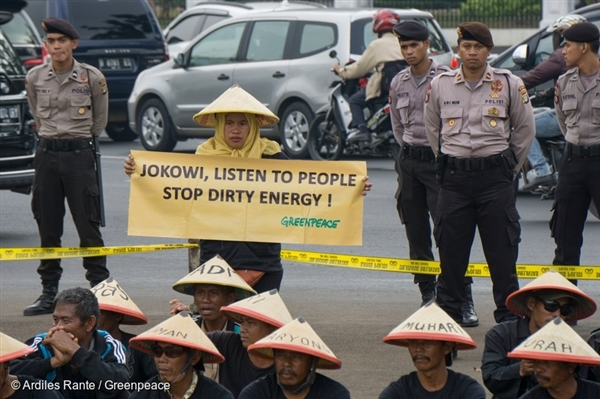 Community from Batang together with Greenpeace in a creative protest in front of Indonesian presidential palace in Jakarta, to show their opposition to the proposed coal-fired power plant in Batang, Central Java.