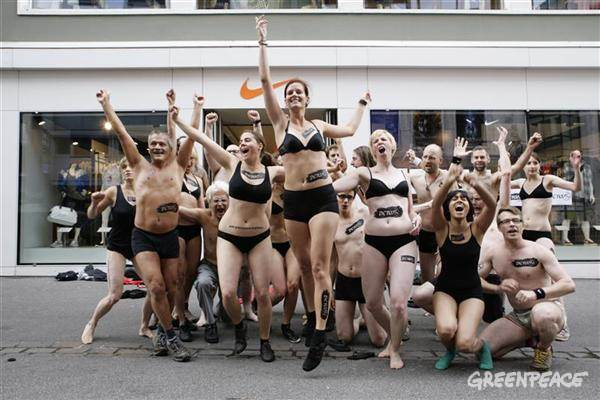 Switzerland -- Greenpeace volunteers surprise shoppers by performing a striptease outside the Nike store in central Basel