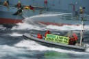 Greenpeace activists try to hinder the transfer