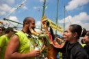 "A crew member from The Rainbow Warrior receives a warm welcome from a Thai puppet during the launch of the Greenpeace ""Turn the Tide"" tour in Bangkok Port on September 17, 2010"