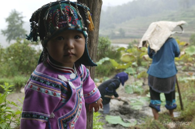 Child in traditional costume in Yunnan