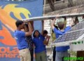 Members of the Solar generation project installing