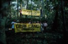 Deni and Greenpeace team hold banner at border