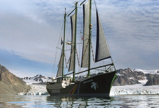 Greenpeace ship Rainbow Warrior in front of the Glacier Fjortende Julibreenon Svalbard.