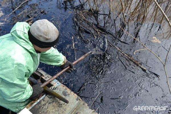 Russian Komi Indigenous community members clean up oil spilled in the Kolva River in the Komi Republic in Northern Russia.