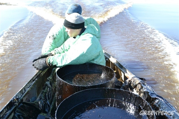 Russian Komi Indigenous community members clean up oil spilled in the Kolva River in the Komi Republic in Northern Russia.