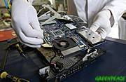Dismantling laptop prior to testing for toxic chemicals.