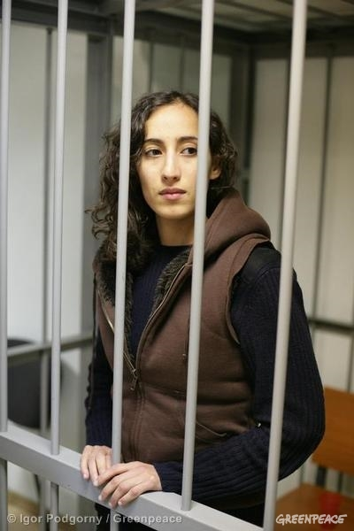 Faiza behind bars in a Russian courtroom in Murmansk