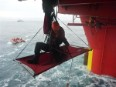 Climber on the Cairn Energy oil rig in the Arctic