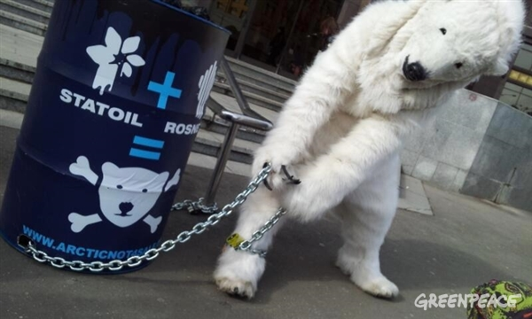 "This morning in Moscow, three polar bears chained themselves to oil barrels with signs saying ""The Arctic is worth more than oil"" and ""We are hostages of your greed"" to protest against the frightening partnership between Norwegian company Statoil and oil spill record-holder Rosneft to drill the Russian Arctic."