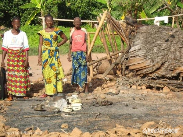 Villagers in DRC after their property was damaged in 2011