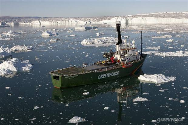 The Greenpeace ship Arctic Sunrise in front of Humboldt glacier