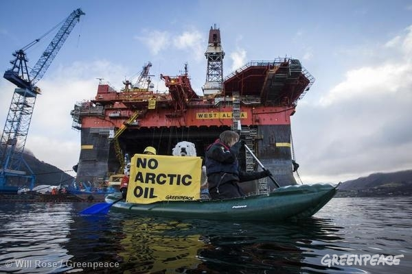 Activists Scale ExxonMobil Rig in Norway on Valdez Anniversary. 03/24/2014 © Will Rose / Greenpeace