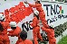 Greenpeace activists label an outer wall of TNC Chemicals Philipp