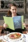 Oceans campaigner Karli Thomas gets served a plate of jellyfish