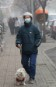 Chinese pedestrian wears a mask to protect