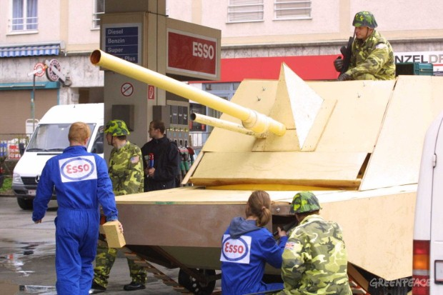 Mock war machine tanks up at an Esso station in Salzburg.