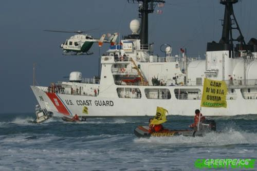 Greenpeace activists protesting in front of the US and Spanish naval base in Rota where there is a heavy presence of military vessels and preparations being made for the Gulf..
