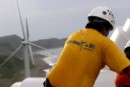 A Greenpeace volunteer on top of a wind turbine