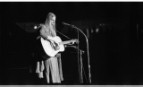 Joni Mitchell on stage at the Amchitka Concert
