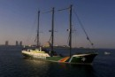 Rainbow Warrior sails into Doha to challenge