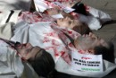 Greenpeace activists visit Spain's governing party in body bags