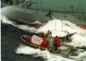 Greenpeace activists alongside a whaling ship