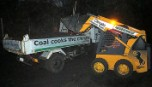 Greenpeace activists load coal from a stockpile the Huntly Power Station