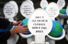 Greenpeace deposited over 30 porcelain toilets on parliament grounds