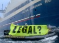 Greenpeace activists display a banner reading