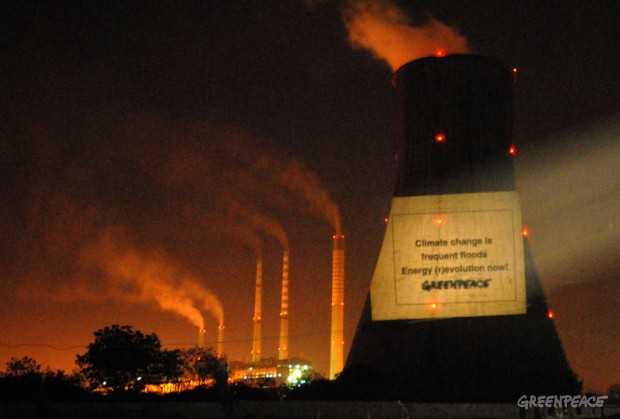 Campaigning for a future free from climate change, Greenpeace activists beam a message on the Raichur Thermal Power plant in Karnataka. Coal burning emits large volumes of carbon dioxide leading to climate change. Climate change will hit India hard. C...