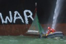 Greenpeace set up peace camp on military supply ship heading for the Gulf