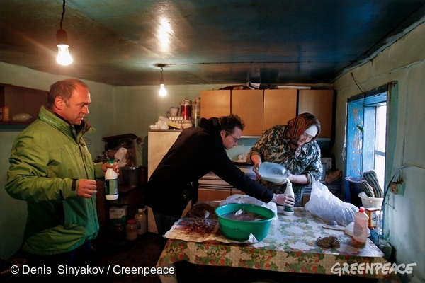 Heinz Smital (left) and Florian Kasser (center), anti nuclear program staff members, sample cow milk at a private house in the village of Muslyumovo, located near the Mayak nuclear complex. Different Nuclear Power Plant providers in Europe, like AXPO in Switzerland or AREVA in France, are provided by reprocessed nuclear fuel, coming from Mayak. The nuclear complex around Mayak is one of the most radioactive wasted landscapes in the world and is closed for journalists or international investigation.