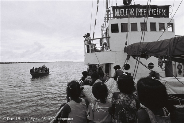 Islanders with their belongings approach the Rainbow Warrior. Nuclear fallout made islanders living on Rongelap making it a hazardous place for this community to continue living in.