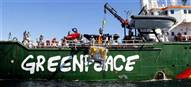 What are the Greenpeace ships doing?