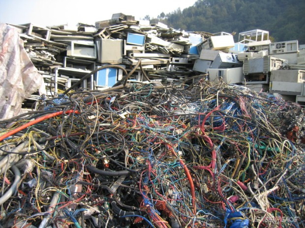 Piles of cables and computer waste awaiting scrapping. Wenling, zhejiang Province, China.