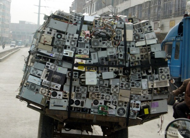 Truck overloaded with hazardous computer waste on the way to scrapping yards.