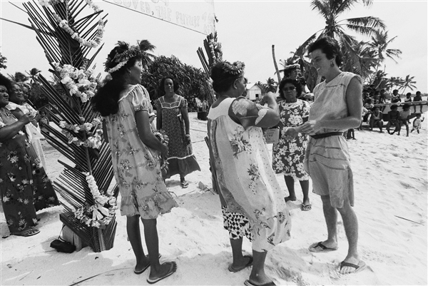 Women of Rongelap island welcome Bunny McDiarmid, who was on the Rainbow Warrior to assist in the evacuation of islanders to Mejato due to a nuclear fallout in 1954 making it a hazardous place for this community to continue living in.