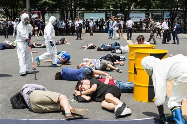 "In Busan, South Korea, activists stage a ""die in"" in protest to a 2016 approval to build two new nuclear reactors in the area."