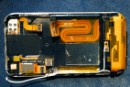 The iPhone with battery and circuitry removed