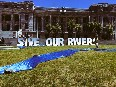 Greenpeace transforms Parliament lawn into a riverbed
