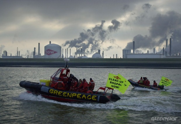 Greenpeace activists on their way to Dow headquarters in the Netherlands to deliver a deadly cargo of waste from the Bhopal site in India, in big yellow barrels.