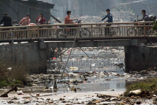 A heavily polluted stream in Guiyu. Along side domestic rubbish the water is badly polluted with toxic waste from the e-waste recycling yards in the town.