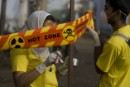 Greenpeace activists put up warning signs