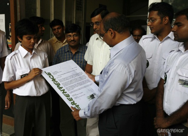 "Greenpeace activists dressed as ""Climate Cops"" act as postmen and deliver 20K petitions signed by car owners and citizens across India to the Director General of the Bureau of Energy Efficiency (BEE), Dr. Ajay Mathur, at Sewa Bhavan in New Delhi deman..."