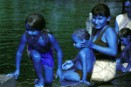 Deni woman and children sitting in the Tapaua