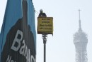 Greenpeace activist displays a banner at