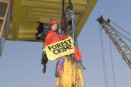 Greenpeace activists climb onboard the timber